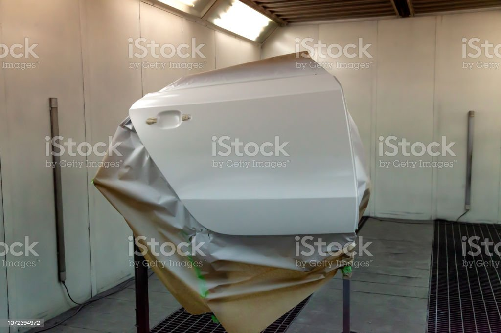 White door from the vehicle during the repair in the workshop for painting the car body stock photo