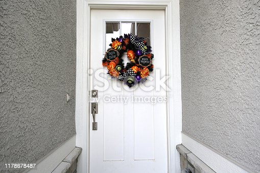 istock White Door Halloween Wreath 1178678487