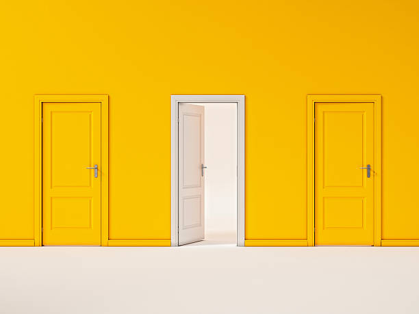 white door on yellow wall, illustration business door - opportunity stock photos and pictures