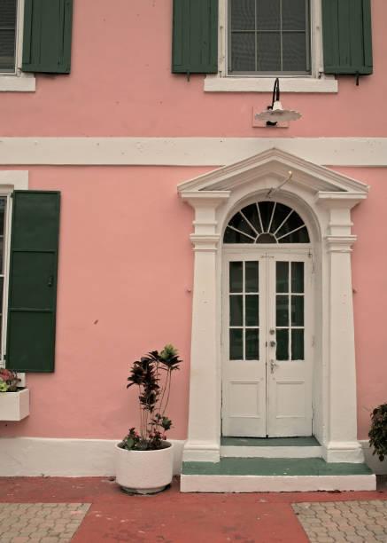 White door pink wall stock photo