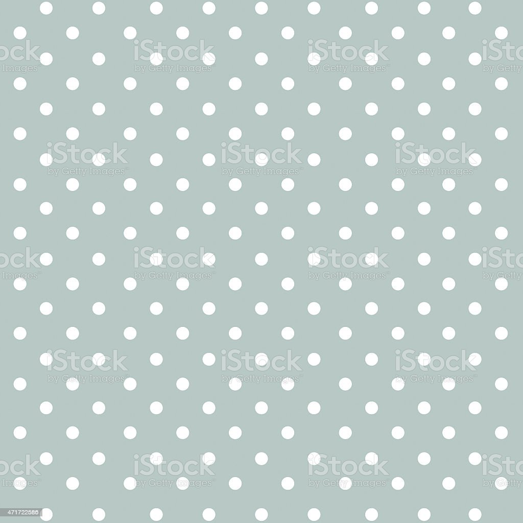 White dots on a light green background stock photo