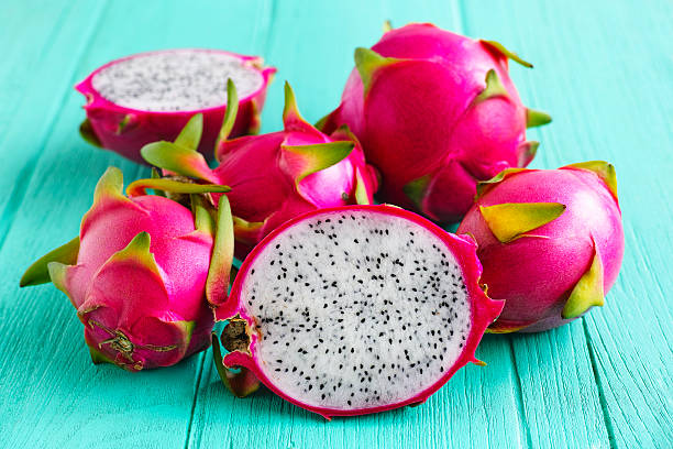 White Dragon Fruit. White Dragon Fruit on an old turquoise wooden table. pitaya stock pictures, royalty-free photos & images