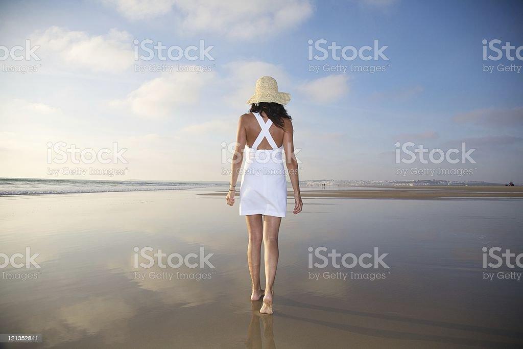white dress straw hat woman stock photo