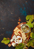 istock White Dry Wine, Cheese With Mold, Nuts, Grape And Cracker, Dark Background, Top View 969306330