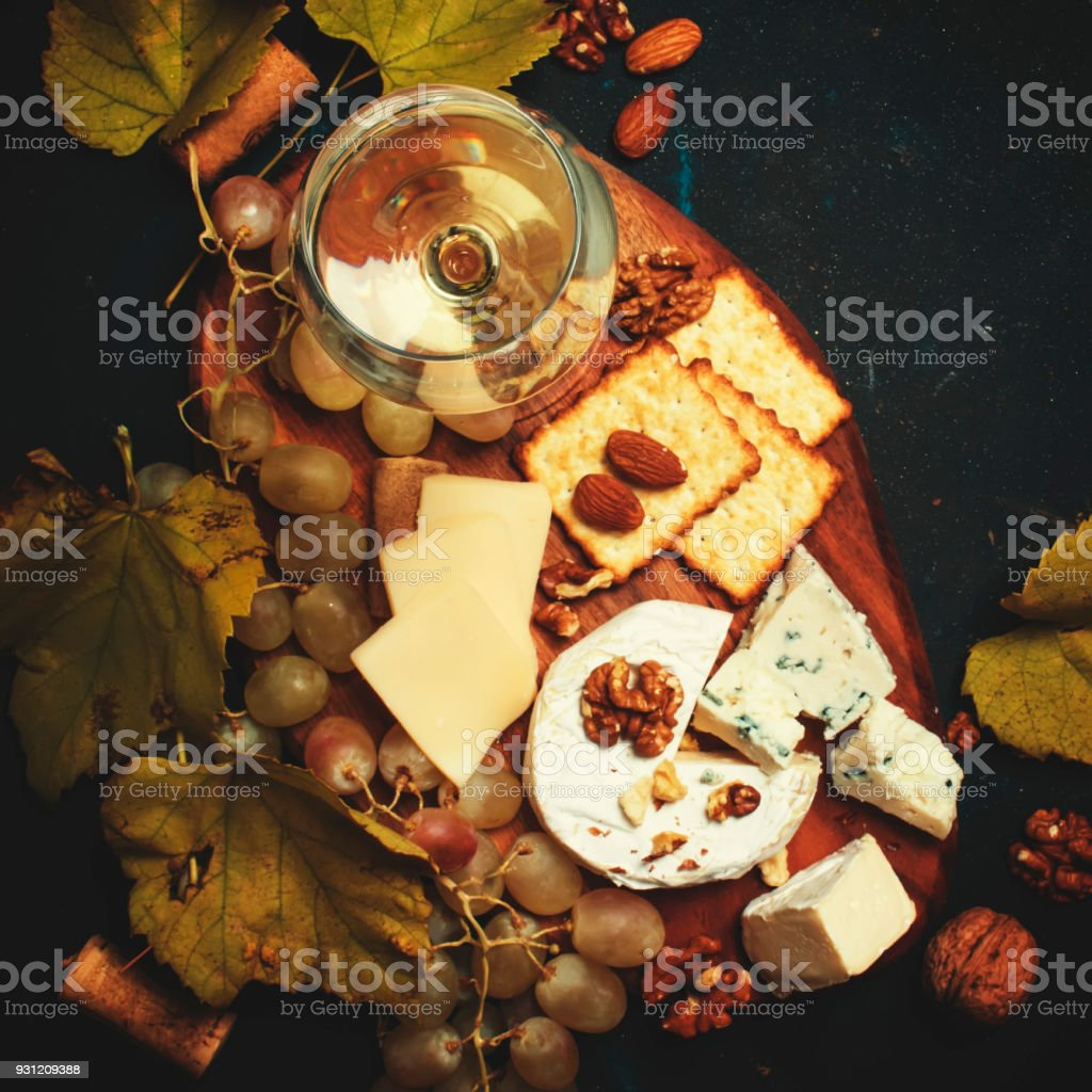 White Dry Wine, Cheese With Mold, Nuts, Grape And Cracker stock photo