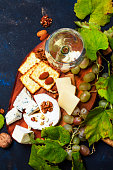 istock White Dry Wine, Cheese With Mold, Nuts, Grape And Cracker 931209794