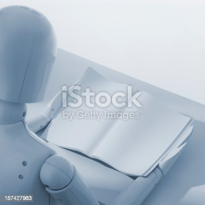 153178960istockphoto White dummy puppet reading empty book 157427983