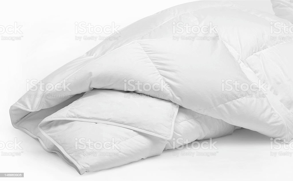 White duvet isolated on a white background stock photo