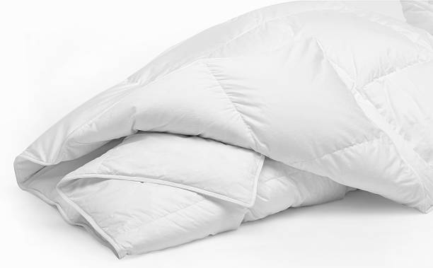 White duvet isolated on a white background White Goose Down Duvet duvet stock pictures, royalty-free photos & images