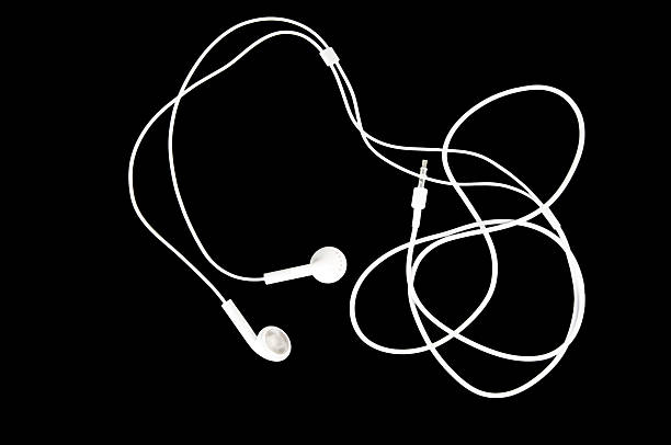 White Earbuds on Black stock photo