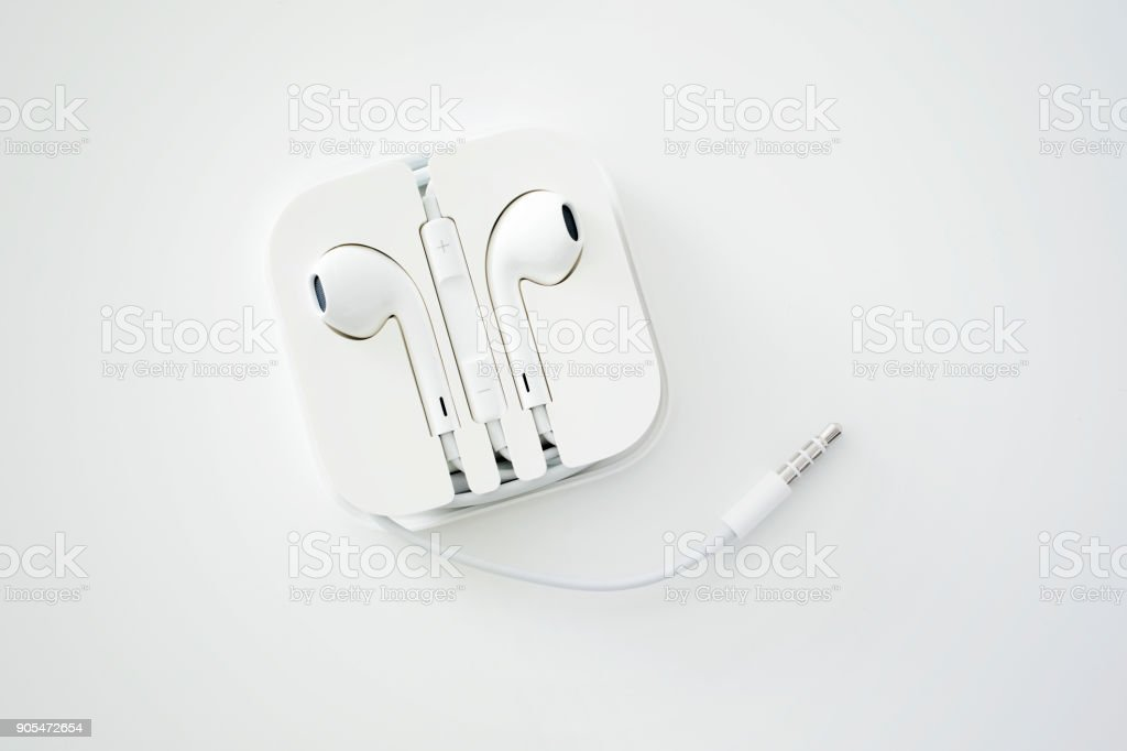 White earphone set on isolated white color stock photo