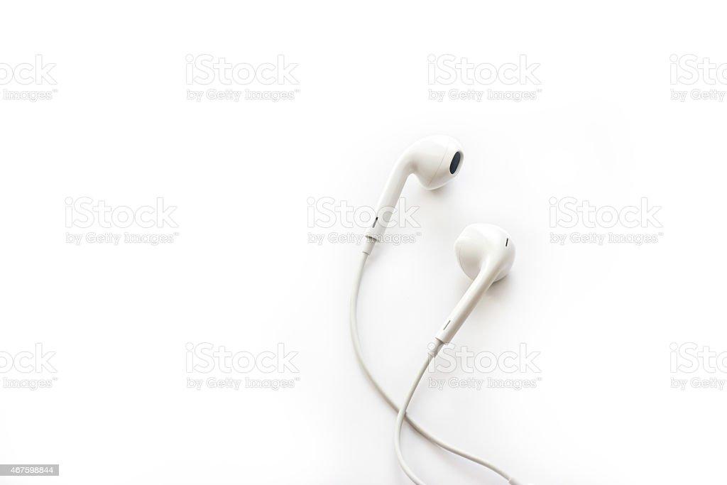 white earphones on white background, blank text stock photo