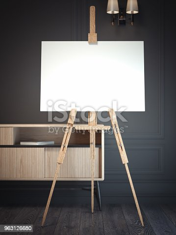 istock White easel stands next to dark wall, 3d rendering 963126680