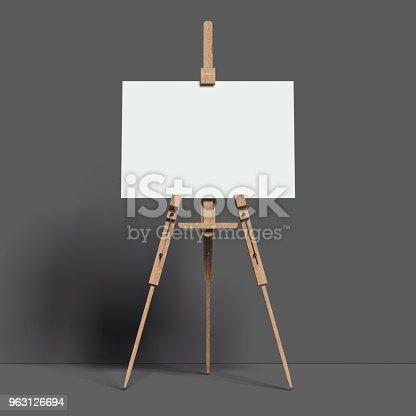 istock White easel stands next to dark wall, 3d rendering 963126694