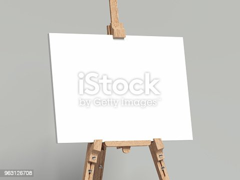 istock White easel stands next to grey wall, 3d rendering 963126708