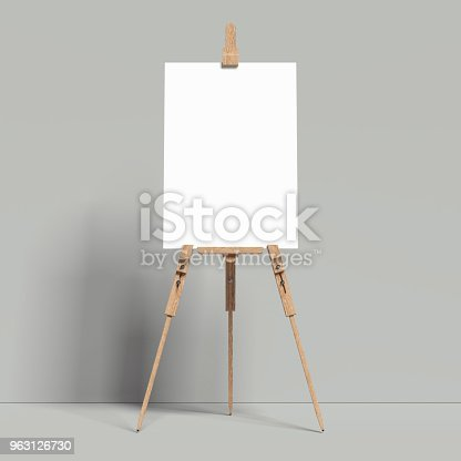 istock White easel stands next to grey wall, 3d rendering 963126730
