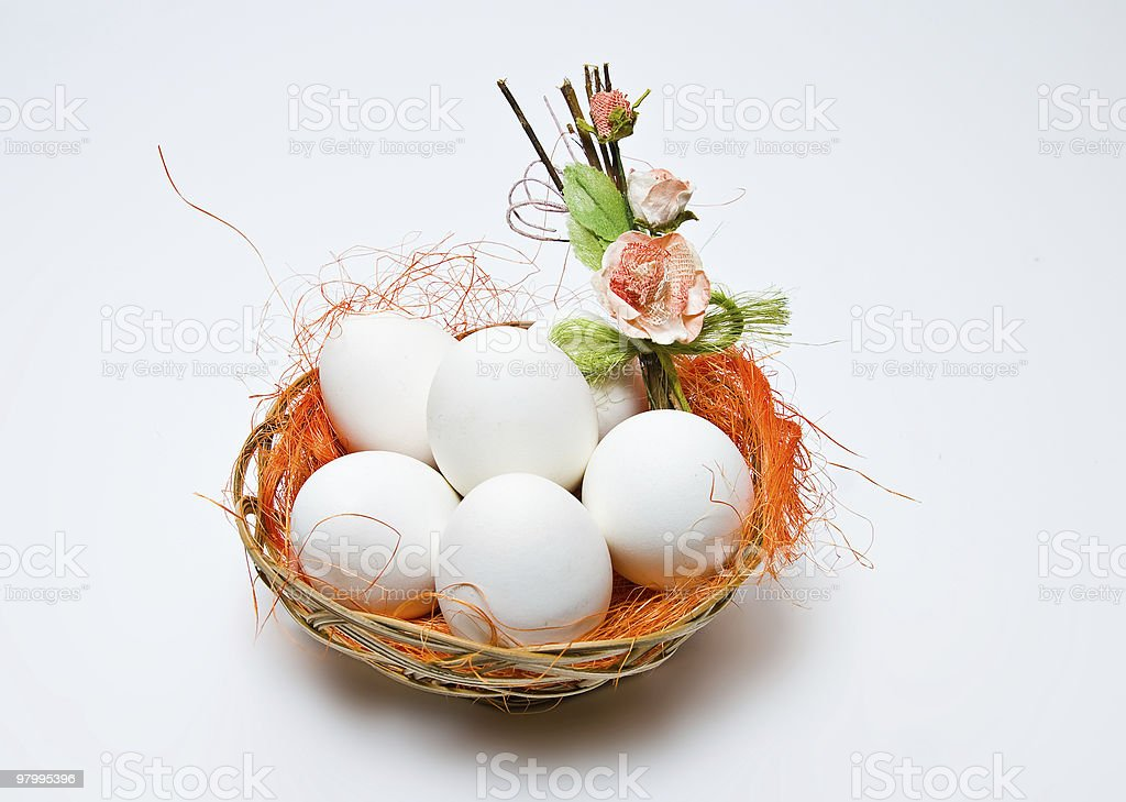 White eggs in a basket royalty free stockfoto