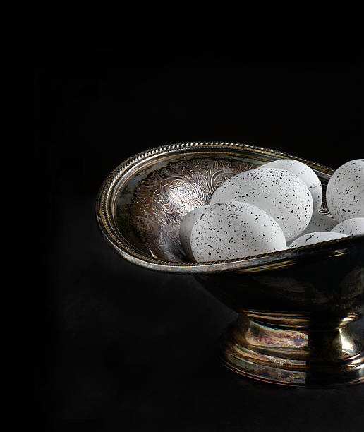 white eggs in antique bowl - rentenpunkte stock-fotos und bilder