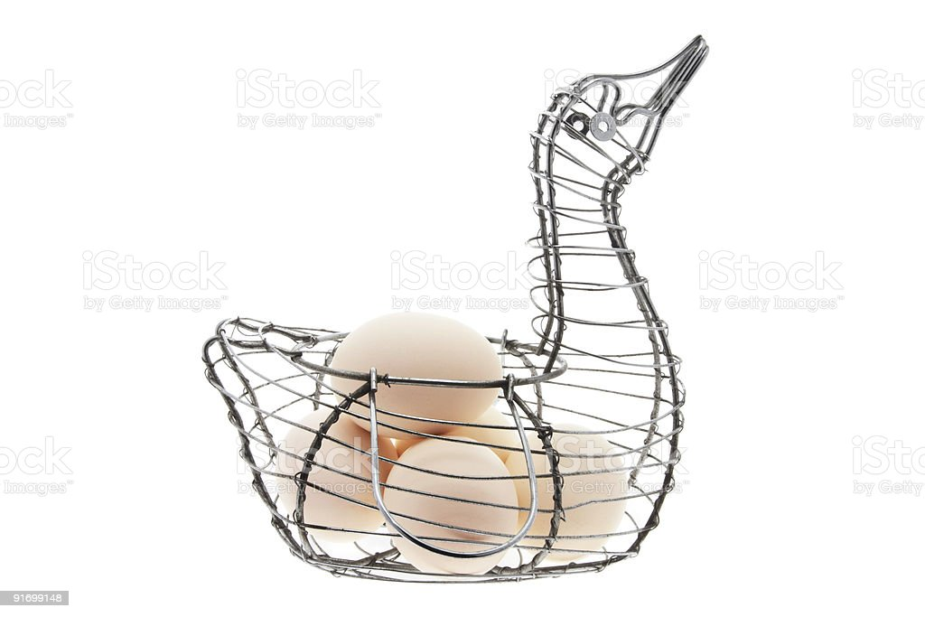 White Eggs on Duck-shaped Wire Basket stock photo