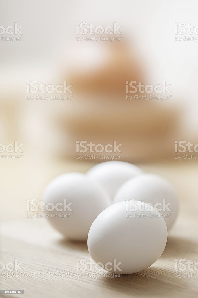 White eggs on the wooden table royalty-free stock photo