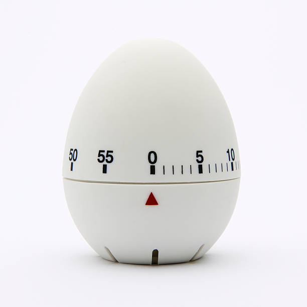 White egg-shaped kitchen timer isolated on white background Kitchen egg timer. timer stock pictures, royalty-free photos & images