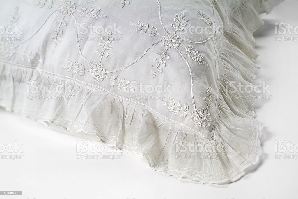 White Embroidered Pillow stock photo