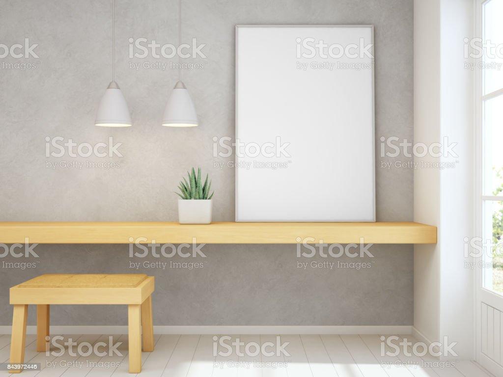 Cadre vide blanc simulé vers le haut sur une table en bois jaune