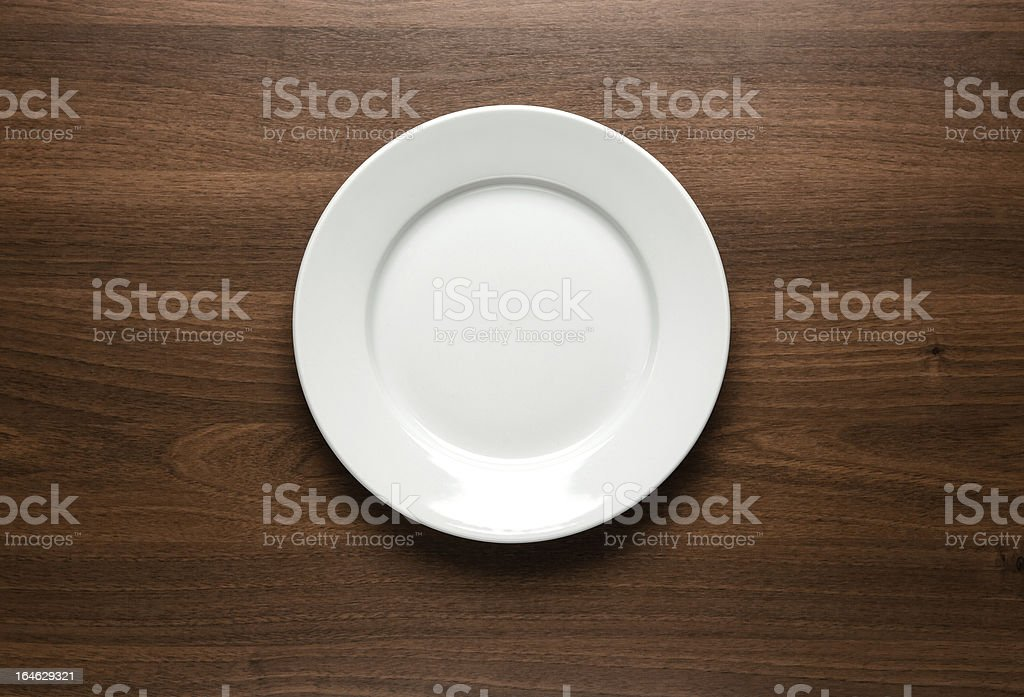White empty plate at the table royalty-free stock photo
