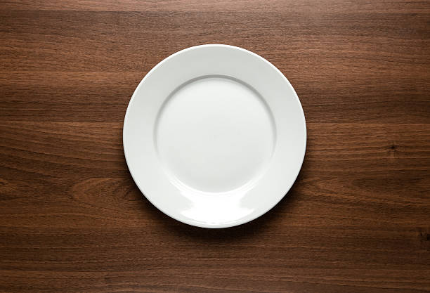 White empty plate at the table stock photo