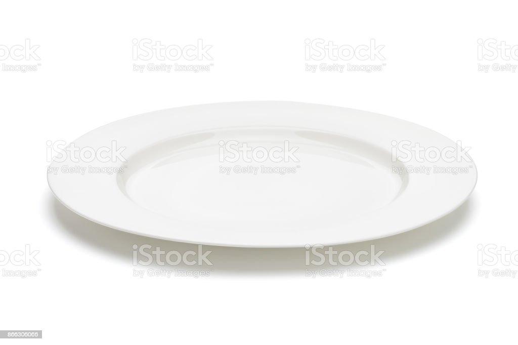 Assiette vide blanc. Tracé de détourage inclus - Photo