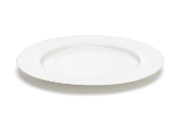 white empty plate. clipping path included - plate stock pictures, royalty-free photos & images