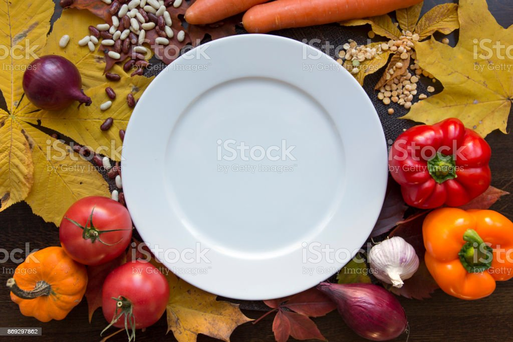 White empty plate with autumn harvest top view royalty-free stock photo