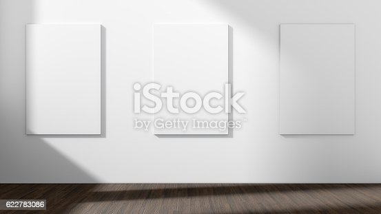 istock White empty room with empty three frame.3D rendering. 622783086