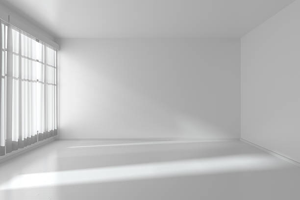 White empty room with flat walls, white floor and window stock photo