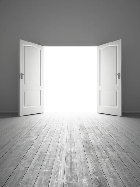white empty room with opened door stock photo
