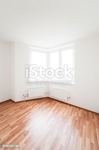 istock white empty room with window 916035730