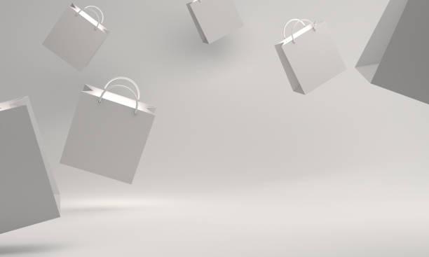 スタジオの照明で白い空のショッピングバッグ. - アイコン プレゼント ストックフォトと画像