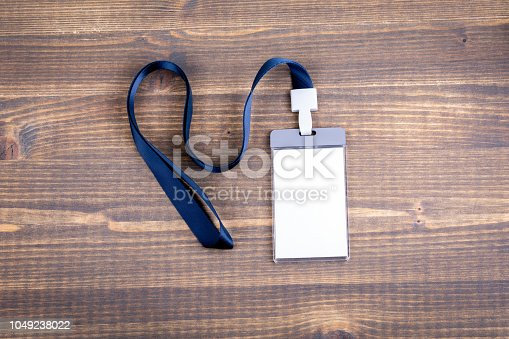 1049305186istockphoto White empty staff identity mockup with blue lanyard. Name tag, ID card 1049238022