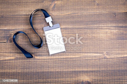 1049305186istockphoto White empty staff identity mockup with blue lanyard. Name tag, ID card 1049238038