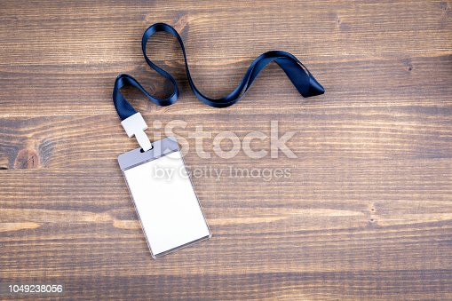 1049305186istockphoto White empty staff identity mockup with blue lanyard. Name tag, ID card 1049238056