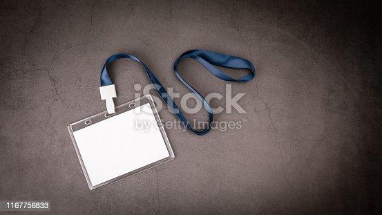 1049305186 istock photo White empty staff identity mockup with blue lanyard 1167756833