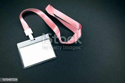 1049305186istockphoto White empty staff identity mockup with pink lanyard 1070457224