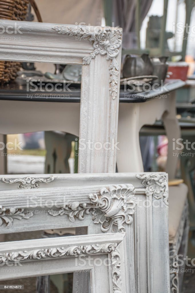 White empty vintage frames at a French street flea market in the city stock photo