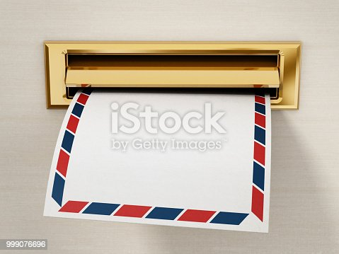 istock White enveloppe being delivered through the mail slot 999076696