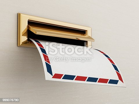 istock White enveloppe being delivered through the mail slot 999076790