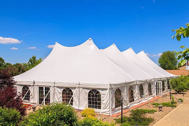 A white event tent in a garden stock photo