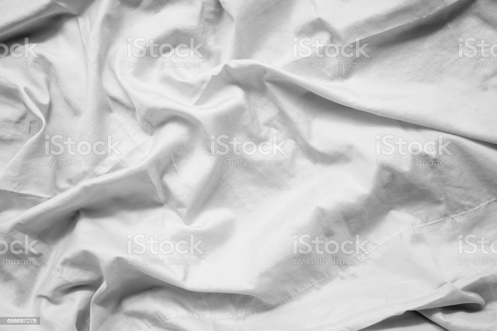 White fabric abstract background concept. white wrinkled silk cloth wave texture satin material stock photo