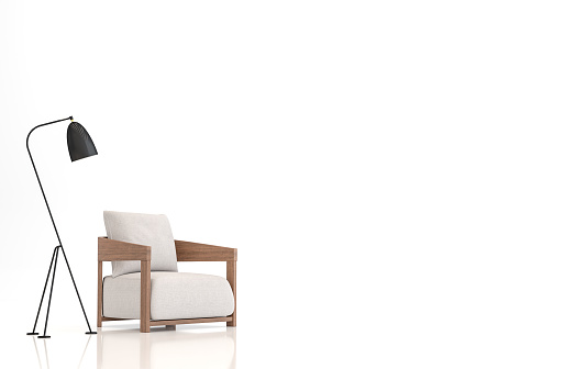 White fabric armchair on white background 3d rendering image.There are clipping path on an armchair and lamp.