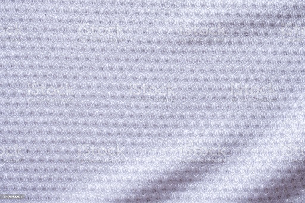 White fabric sport clothing football jersey with air mesh texture background - Royalty-free Abstract Stock Photo