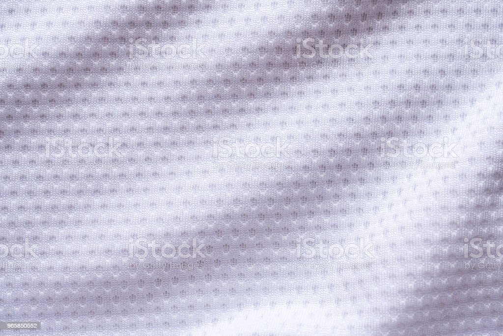 White fabric sport clothing football jersey with air mesh texture background - Royalty-free Athlete Stock Photo